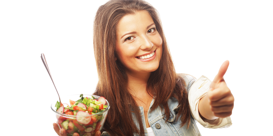 Woman with vegetable salad