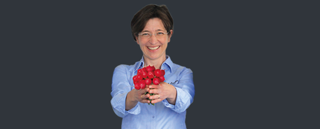 Internships R&D: woman holding radishes