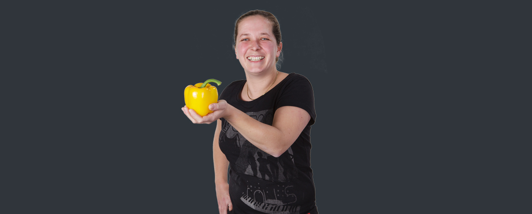 Woman with yellow sweet pepper